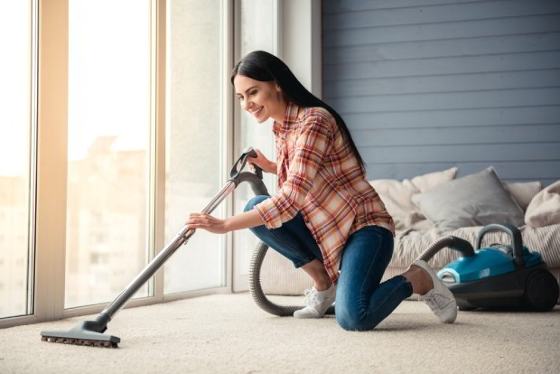 Using a vacuum cleaner while cleaning floor at home
