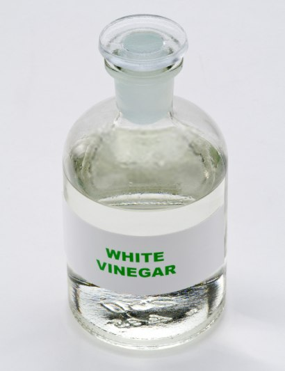 A cup of white vinegar