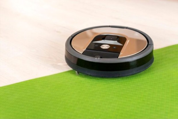 A picture showing a Roomba vacuum cleaning robot in the background