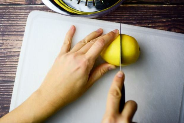 How to cut lemon in two halves, in readiness for cleaning cooler