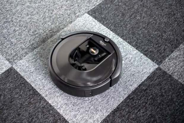 A picture of an iRobot Roomba on the background