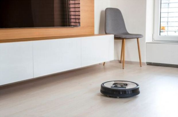A picture of an automated Roomba in the background
