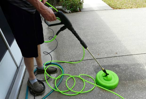 Hover the surface cleaner across the driveway