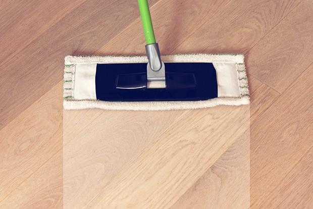 Wipe the cleaner up with a microfiber mop