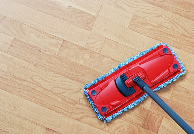 Go over the floor using the clean mop