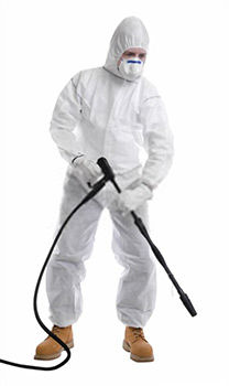 A cleaner dressed in full protective clothing before using pressure washer