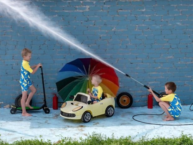 Use of a pressure washer in the wrong set up; child holding the equipment and other children playing around