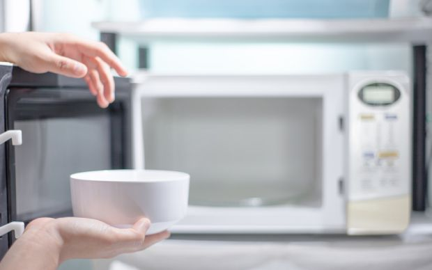 Place a bowl of water and vinegar inside