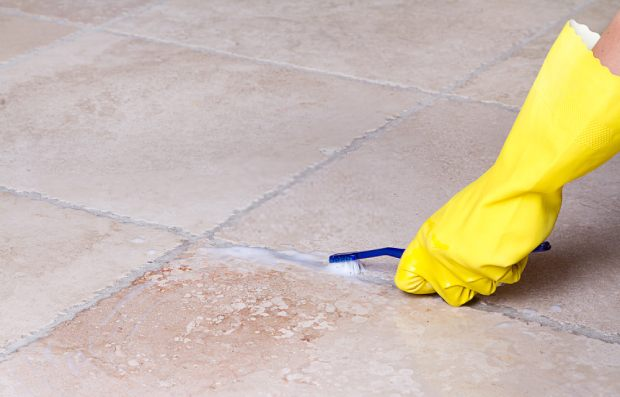 Clean tile grout with baking soda and a toothbrush